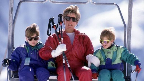 The Princess of Wales with her sons William and Harry on the chair lift during a skiing holiday in Lech, Austria, April 1991. (Photo by Jayne Fincher/Princess Diana Archive/Getty Images)
