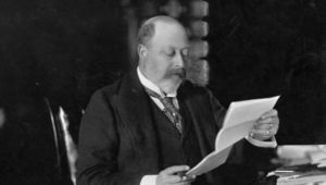 King Edward VII, (1841 - 1910), who ascended the British throne in 1901, as Prince of Wales, reading at Sandringham, Norfolk