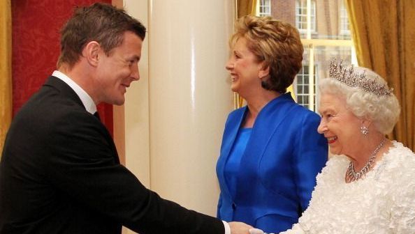 Queen Elizabeth II shakes hands with Brian O\'Driscoll , Irish rugby captain before a State Dinner at Dublin Castle, on May 18, 2011 in Dublin, Ireland. The Duke and Queen\'s visit to Ireland is the first by a British monarch since 1911. An unprecedented security operation is taking place with much of the centre of Dublin turning into a car-free zone. Republican dissident groups have made it clear they are intent on disrupting proceedings. (Photo by Irish Government - Pool/Getty Images)