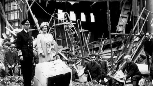 King George VI (1895 - 1952) and Queen Elizabeth (1900 - 2002) survey some of the damage after the bombing of Buckingham Palace, London, during the Second World War. (Photo by Fox Photos/Getty Images)