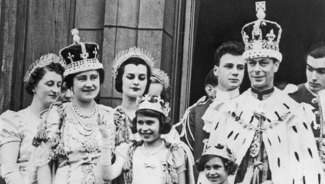 The royal family on the balcony at Buckingham Palace September 12, 1937 after the coronation of King George VI. King George VI (R) stands with Princess Elizabeth (C) and Princess Margaret. Buckingham Palace announced that Princess Margaret died peacefully in her sleep at 1:30AM EST at the King Edward VII Hospital February 9, 2002 in London. (Photo by Getty Images)