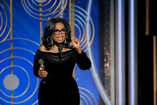 In this handout photo provided by NBCUniversal, Oprah Winfrey accepts the 2018 Cecil B. DeMille Award speaks onstage during the 75th Annual Golden Globe Awards at The Beverly Hilton Hotel on January 7, 2018 in Beverly Hills, California. (Photo by Paul Drinkwater/NBCUniversal via Getty Images)