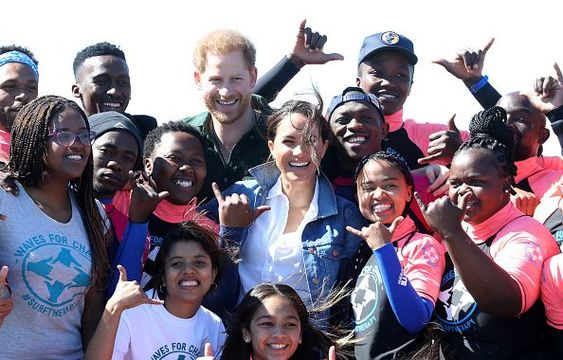 Prince Harry, Duke of Sussex and Meghan, Duchess of Sussex poses with surf mentors as they visit Waves for Change, an NGO, at Monwabisi Beach on September 24, 2019 in Cape Town, South Africa. Waves for Change supports local surf mentors to provide mental health services to vulnerable young people living in under resourced communities. (Photo by Chris Jackson - Pool/Getty Images)