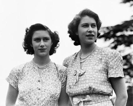 Princess Elizabeth and her sister Princess Margaret (1930 - 2002) at the Royal Lodge, Windsor, UK, 8th July 1946.