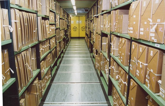 Documents stacked inside the repository at The National Archives, in Kew.