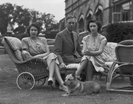 King George VI (1895-1952) with his daughters Princess Elizabeth and Princess Margaret (1930 - 2002) in the grounds of Windsor Castle in Windsor, England on July 08, 1946. (Photo by Lisa Sheridan/Studio Lisa/Getty Images)