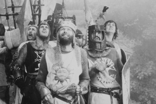 British comedians Eric Idle, John Cleese, Graham Chapman, Terry Jones and Michael Palin in a scene from \'Monthy Python and the Holy Grail\', directed by Terry Gilliam and Terry Jones, 1975 (Photo by Warner Bros./Hulton Archive/Getty Images)