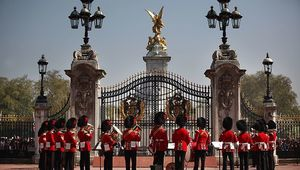 The Band of the Coldstream Guards form up around the main gate of Buckingham Palace during the Changing of the Guard ceremony on April 20, 2011 in London, England. Soldiers guard Queen Elizabeth II and other royals at Buckingham Palace in a 24 hour rotation with a ceremonial hand over at 11.30 in the morning. (Photo by Peter Macdiarmid - WPA Pool /Getty Images)
