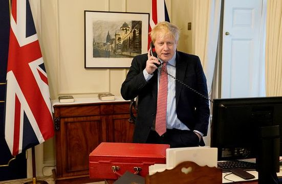 Prime Minister Boris Johnson on the telephone to Queen Elizabeth II for her Weekly Audience during the coronavirus (COVID-19) pandemic at 10 Downing Street on March 25, 2020 in London, England. (Photo by Andrew Parsons-WPA Pool/Getty Images)