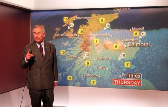 Prince Charles, Prince of Wales reads the weather in the Six O\'Clock studio during a tour of the BBC Scotland Headquarters where they met staff to celebrate sixty years of BBC Scotland Television on May 10, 2012 in Glasgow, Scotland. (Photo by Andrew Milligan - WPA Pool/Getty Images)