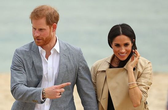 Prince Harry, Duke of Sussex wearing a Oura Health fitness tracker ring and Meghan, Duchess of Sussex walk at South Melbourne Beach on October 18, 2018 in Melbourne, Australia. BeachPatrol is a network of volunteers who are passionate about keeping Melbourne\'s beaches and foreshores clear of litter to reduce the negative impact of litter on the marine environment and food chain, and provide a safe environment for the public to enjoy their local beach.The Duke and Duchess of Sussex are on their official 16-day Autumn tour visiting cities in Australia, Fiji, Tonga and New Zealand. (Photo by Scott Barbour/Getty Images)