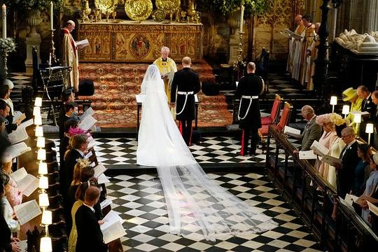 Prince Harry and Meghan Markle during their wedding ceremony in St George\'s Chapel at Windsor Castle on May 19, 2018 in Windsor, England. (Photo by Owen Humphreys - WPA Pool/Getty Images)