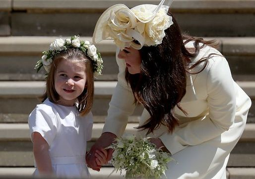 Princess Charlotte of Cambridge stands on the steps with her mother Catherine, Duchess of Cambridge after the wedding of Prince Harry and Ms. Meghan Markle at St George\'s Chapel at Windsor Castle on May 19, 2018 in Windsor, England. (Photo by Jane Barlow - WPA Pool/Getty Images)