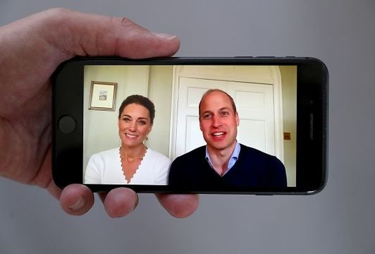 In this photo illustration Prince William, Duke of Cambridge and Catherine, Duchess of Cambridge speak to crisis volunteers on a video-call to mark the first anniversary of Shout85258 on May 15, 2020 in London, England. (Photo by Chris Jackson/Getty Images)