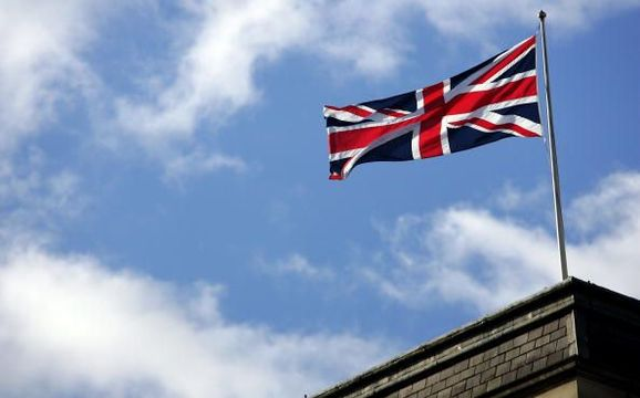The Union Jack flies during Remembrance Sunday ceremonies on November 11, 2007 in London. Queen Elizabeth II led the Remembrance Sunday ceremony commemorations to remember the sacrifices made by Britain\'s war dead. (Photo by Gareth Cattermole/Getty Images)