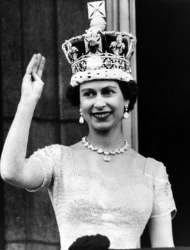 Queen Elizabeth II waves to the crowds from the balcony of Buckingham Palace, on June 2, 1953.