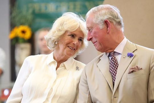 Prince Charles, Prince of Wales and Camilla, Duchess of Cornwall look at eachother as they reopen the newly-renovated Edwardian community hall The Strand Hall during day three of a visit to Wales on July 4, 2018 in Builth Wells, Wales. (Photo by Chris Jackson/Getty Images)