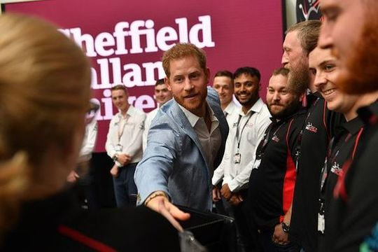 Prince Harry shaking hands in Sheffield.