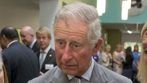 Prince Charles holding a cup of tea
