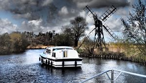 Taking a leisurely cruise on the Norfolk Broads.