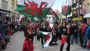 St. David\'s Day parade, Cardiff. A riot of Welsh flags is seen on St. John Street, in 2014.