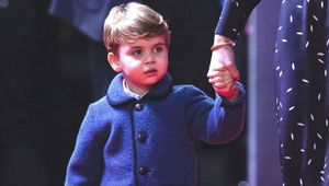 Prince Louis holding his mother Kate Middleton\'s hand at the London Palladium in Dec 2020.