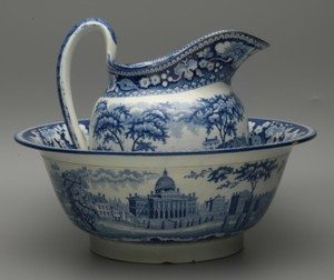 Blue and white transferware bowl and pitcher set with an image of the Boston State House, made by Staffordshire potter John Rogers, circa 1815-1830