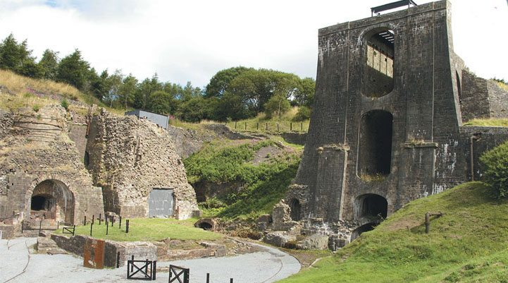 Blaenavon's Balance Tower is its most impressive sight. Built in 1839, the tower used water power lifting carloads of iron ore to be fed into a battery of smelting furnaces on the left.