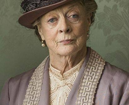 Maggie Smith wearing a hat