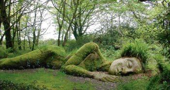 The supine Mud Maid sleeps amid many Heligan surprises.