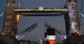 Tower Bridge opens at night for the distinctive funnels of the paddle-wheel steamship Waverley.