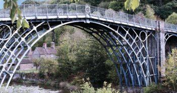 A train crossing a bridge over a river